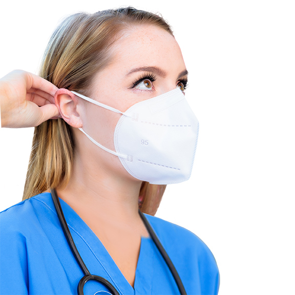respirator mask on woman's face - side view